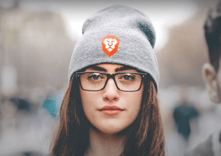 Girl wearing hat with the Brave browser logo