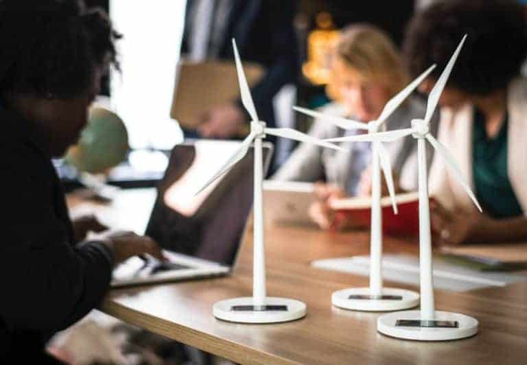 Web designers with toy wind turbines on the desk
