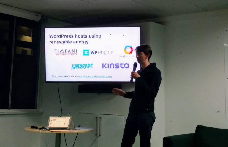 Tom Greenwood presenting at WPLDN in front of a slide showing green WordPress hosts including Kinsta, Timpani, Raidboxes, WP Engine and Google Cloud Platform