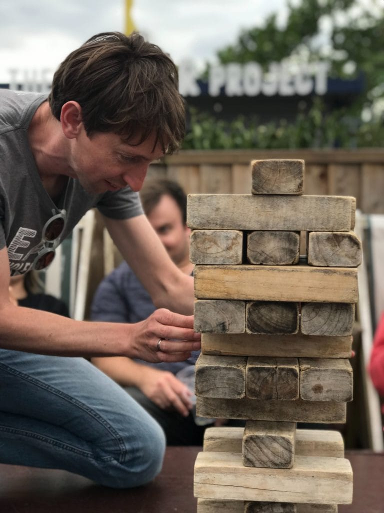 Managing Director Tom Greenwood playing jenga with the team on the team day