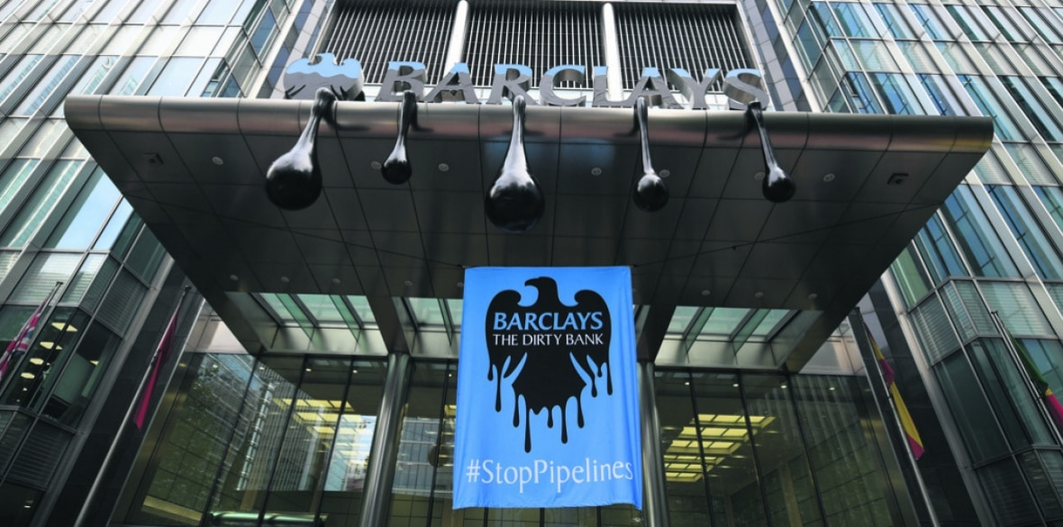 Dirty bank banner hung at Barclays HQ entrance by Greenpeace