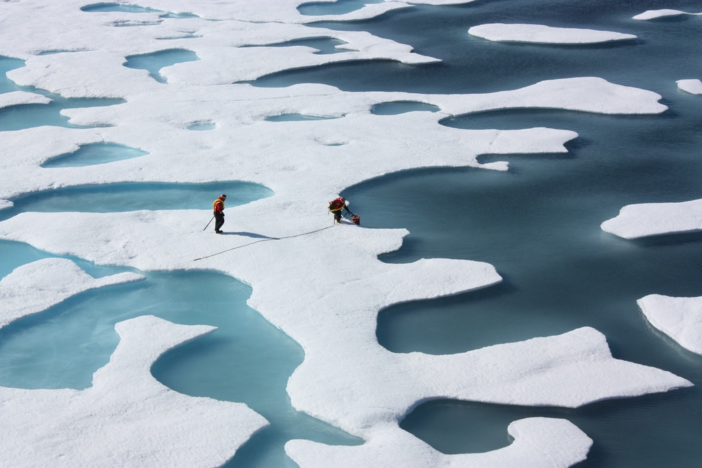 Scientists investigate arctic sea ice melt ponds