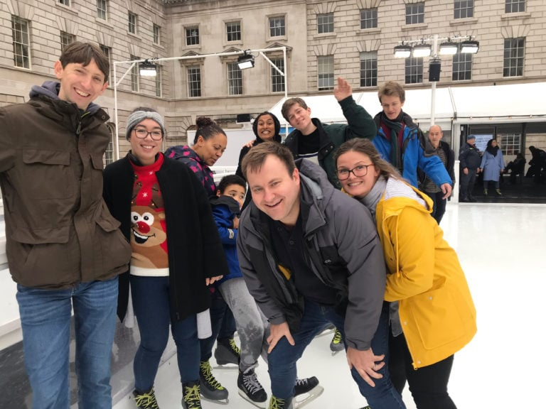Image of team members having fun at a team day ice skating at Somerset House