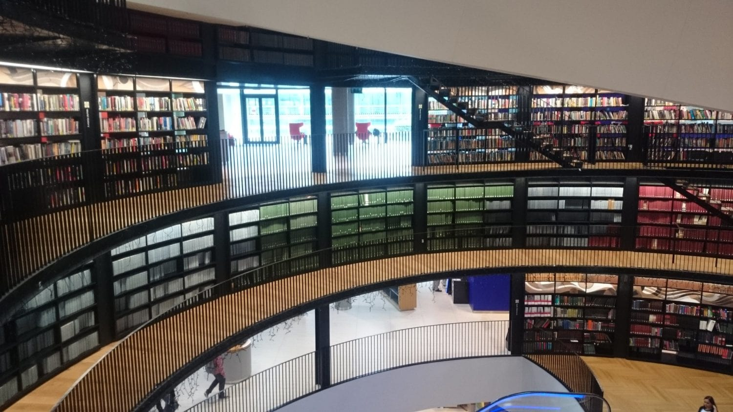 Interior walkways of Birmingham Library lined with books