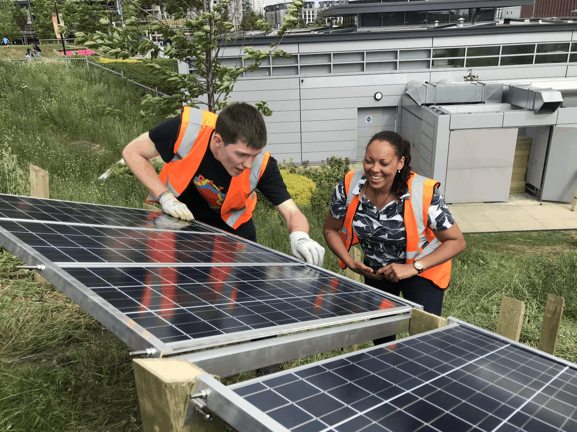 image of jerome and rachael installing solar panels