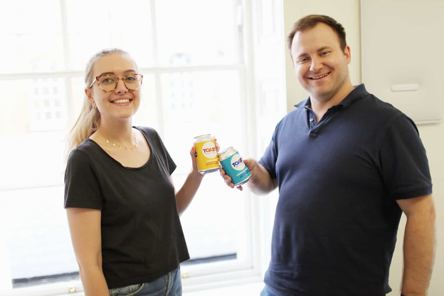 image of tyron and caoilainn from wholegrain holding toast ale