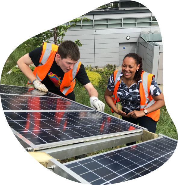 image of rachael and jerome building solar panels