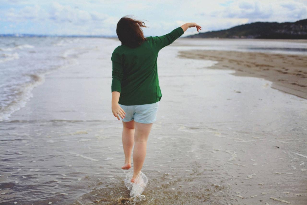 Girl barefoot on beach